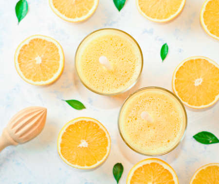 Orange juice in a glass, top view, slices of oranges, straw Stock fotó - 133831699