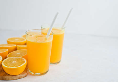 Freshly squeezed orange juice and slices of orange fruit isolated on white Stock fotó - 133831704