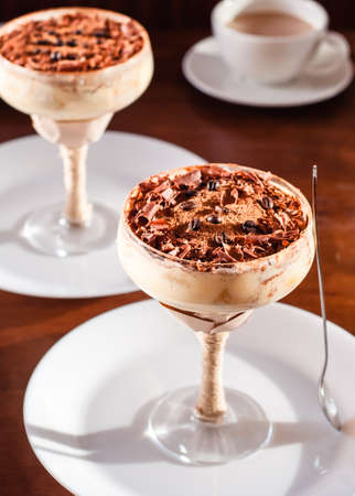 Italian dessert tiramisu in an elegant cocktail glass Stock fotó - 133832245