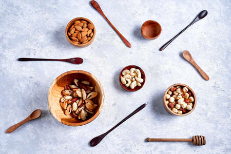 Variety of nuts in wooden bowls pattern