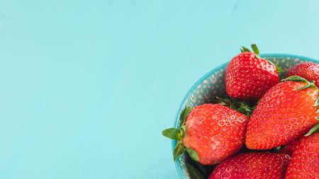 Bright print bowl of fresh strawberries on blue wooden Stock fotó - 133832252