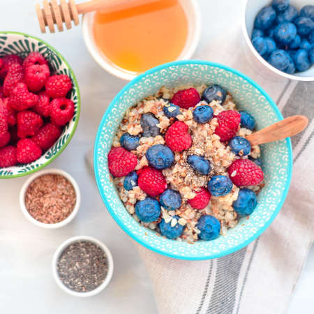 Breakfast buckwheat porridge with raspberries and blueberries Stock fotó - 133832258