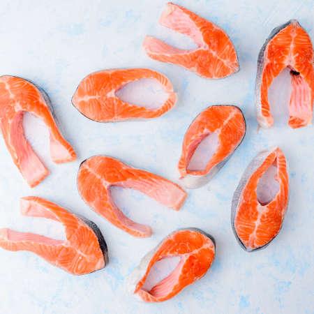 Raw salmon steaks pattern on a blue 写真素材