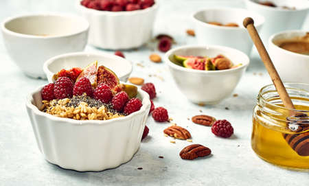oatmeal with raspberries, figs, chia seeds and nuts
