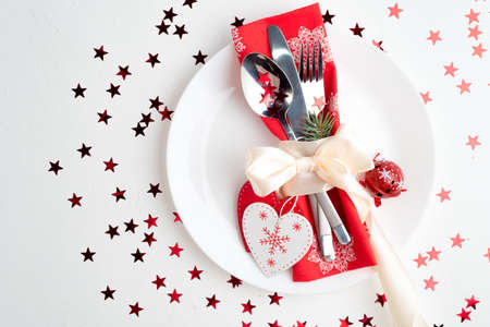 Christmas table place setting. Holidays background, top view