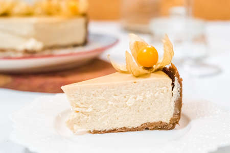 New York cheesecake garnished with physalis on a colorful background