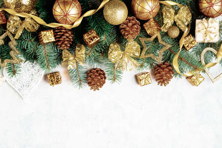 Christmas board. Christmas background golden cones, Christmas decorations, balls, bows, place for text
