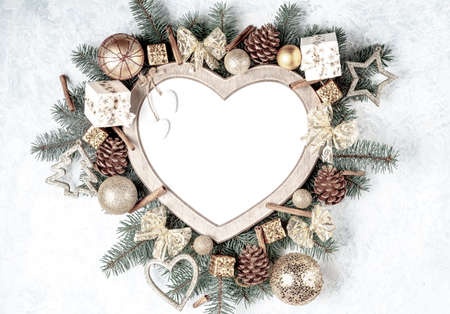 Christmas card, heart-shaped frame, with Christmas decorations. Stock fotó
