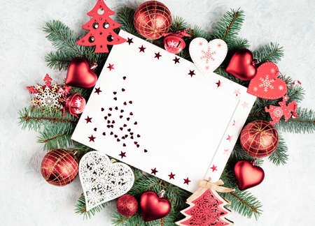 Red christmas background, frame decorated with christmas decorations, red, heart, ball, christmas tree, star, angel, bell space for text Stock fotó