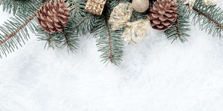Christmas creative background border, gold color, cones, branches