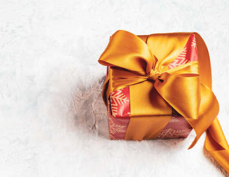 Christmas gift, red box with a golden bow, can also be used as a gift for St. Valentines Day