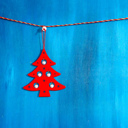 Christmas card with stars, fir and fir-cone on wooden