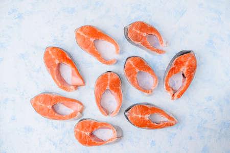 Raw salmon steaks pattern on a blue Stock fotó