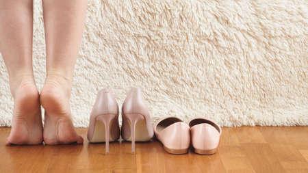 Beautiful women's feet and legs on white