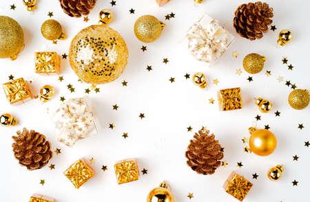 Christmas golden decoration, cones balls glitter Фото со стока