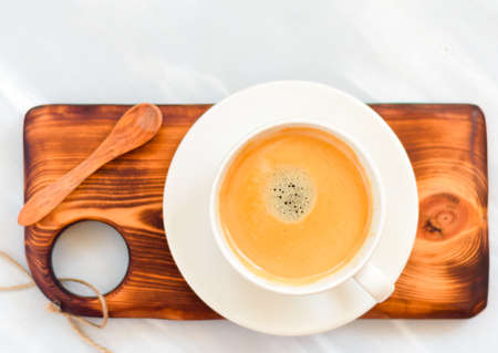 cup of coffee with foam over a wooden gray table, top view Stock fotó