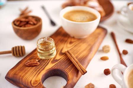 breakfast pattern, coffee, honey, cinnamon sticks, nuts, sugar. Good morning concept.
