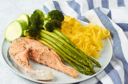 Healthy food, steamed salmon, with steamed vegetables.