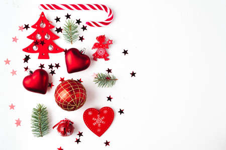 Christmas composition with fir tree branches and holiday ornament on white Stock Photo