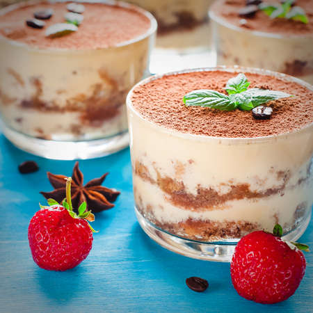 Strawberry dessert tiramisu on a brown background Stock Photo