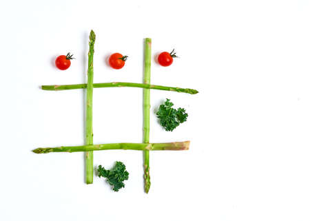 tic tac toe with food, asparagus kale, tomato, top view