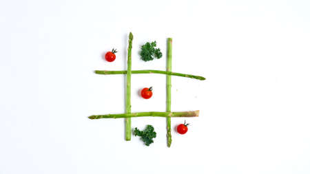 Tic tac toe with food on white