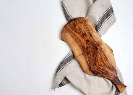 beautiful wooden kitchen background cutting board over kitchen towel on white background
