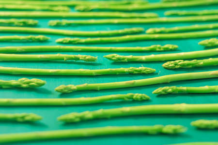 Fresh green asparagus pattern, top view. Food background asparagus flat lay