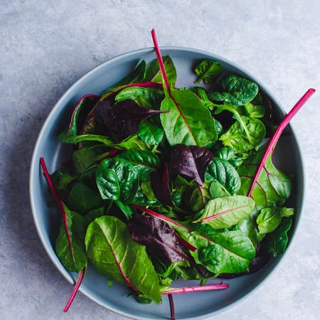 chard salad in blue bowl top view