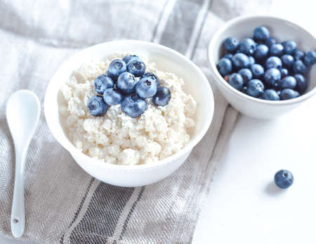 Cottage cheese with blueberries on wood Reklamní fotografie