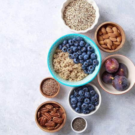 Healthy breakfast of superfoods, quinoa, honey, nuts figs coffee Banco de Imagens