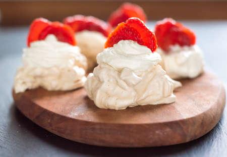 gourmet dessert pavlova strawberry on a blue background