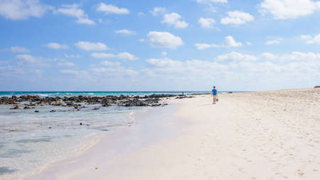 freedom concept, a man walks along the beach on the island of Fuerteventura Spain 版權商用圖片