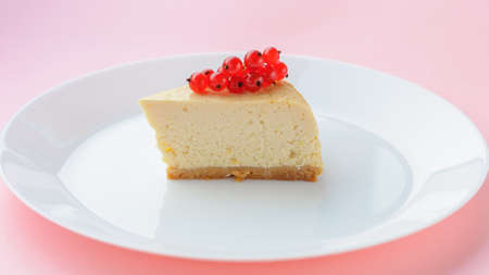 Slice of Plain New York Cheesecake on white plate on wooden background 版權商用圖片