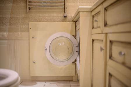 washing machine in bathroom, laundry concept Banco de Imagens