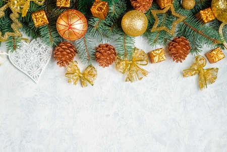 Christmas Border - tree branches with golden decor isolated on white, horizontal banner