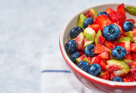 fig strawberry blueberry fruit salad, concept diet and healthy eating