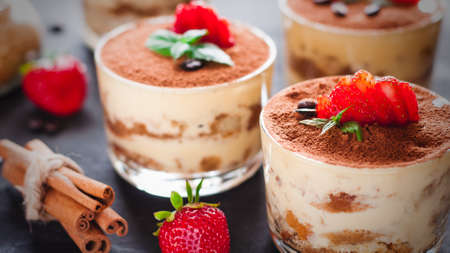 Strawberry dessert tiramisu on a brown background