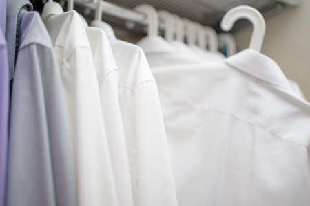 white men's shirts on the shoulders in the closet