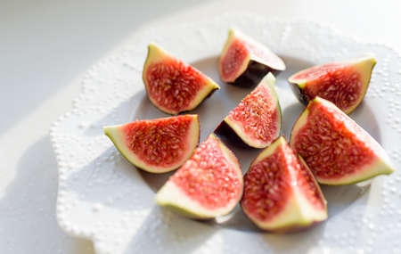 Figs fruits isolated on a white plate, top view