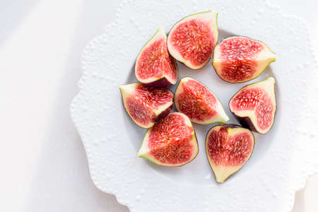 chopped figs on a white ceramic plate
