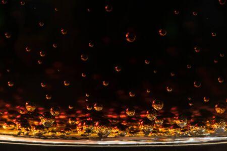 tridimensional: Rising orange bubbles