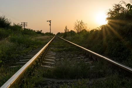 iron: Dramatic sunset at the railway tracks Stock Photo