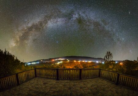 Milky way over the Pestera village in Piatra Craiului mountains from Romania