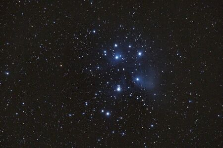 M45 - the Pleiades, Seven Sisters, Deep Sky Astrophoto, Science. the plejades M45 open star cluster in the constellation of taurus. Stock Photo