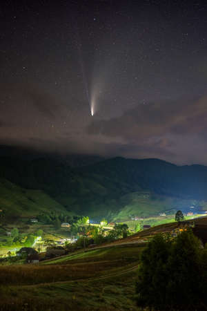 Comet C/2020 F3 NEOWISE over a mountain village from Romania