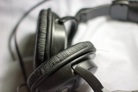 white sheet: headphones on a white sheet close up