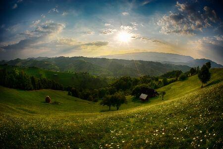 bran: Evening, sunset on mountain hills of Simon village. Bran.