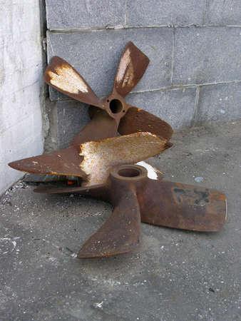 Rusty old ship screws on quay Stock Photo