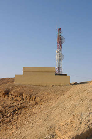 Tower GSM of communication in desert in mountains Stock Photo
